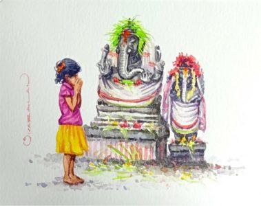 Girl praying to Ganesha